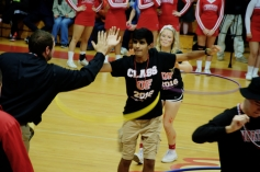 Prateet Shah gives Mr. Rizzo a high five during the hula hooping competition (Photo by Nick Dirschel)