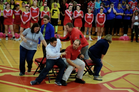Teachers scramble to their seats (Photo by Nick Dirschel)