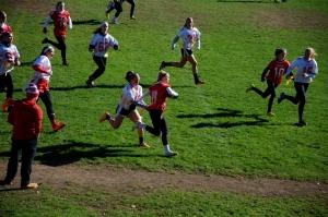 Julia runs the ball for a first down (Photo by Nick Dirschel)
